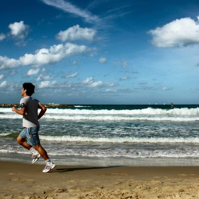 sportsman running on the beach